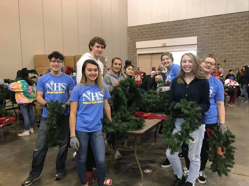 students and a Christmas tree